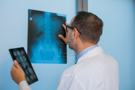 Doctor with tablet and x-ray picture