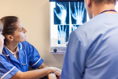 Doctors examining x-ray images