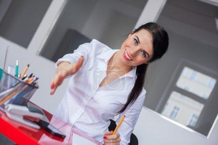 Businesswoman extending hand to handshake