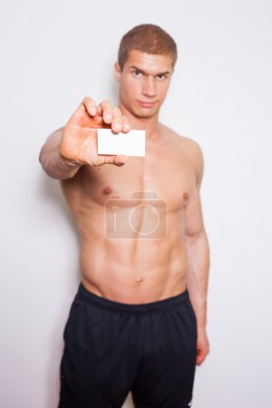 Bodybuilder with business card