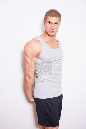 Muscled man posing