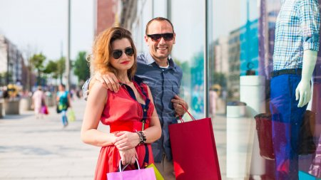 Beautiful couple with shopping bags
