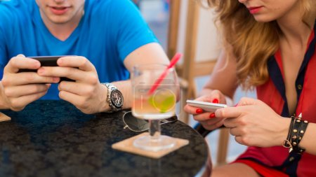 Couple using mobile phones