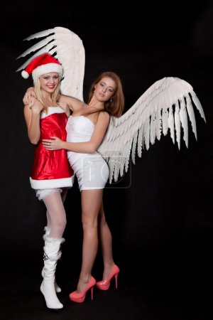 Girls sexy Santa Claus and Angel