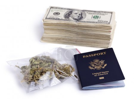Photo for A USA passport, a zip-lock plastic bag containing marijuna buds and a large stack of 100 US dollar money notes isolated on white background. - Royalty Free Image