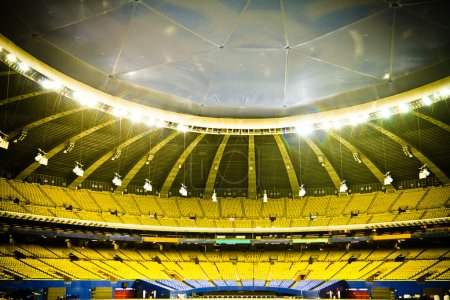 Empty stadium with yellow and blue seats