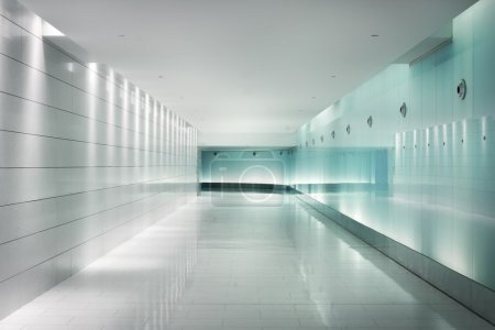 Glass walls in an underground corridor in futuristic style