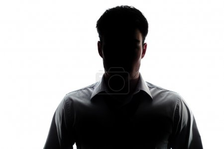 Businessman portrait silhouette wearing a open collar shirt