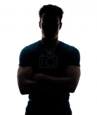 Male figure in silhouette looking at the camera