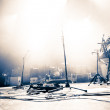 Empty illuminated stage with drumkit, guitar and m...