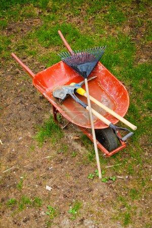 Old Wheelbarow with gardening tools