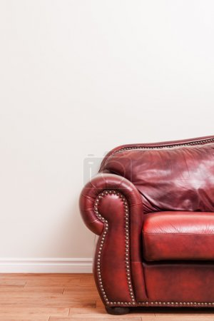 Photo for Luxurious Red Leather Couch Detail in front of a blank wall to ad your text, logo, images, etc. - Royalty Free Image