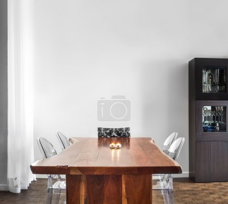 Photo for Modern and Contemporary dining room table and decorations with blank wall for your text, image or logo. - Royalty Free Image