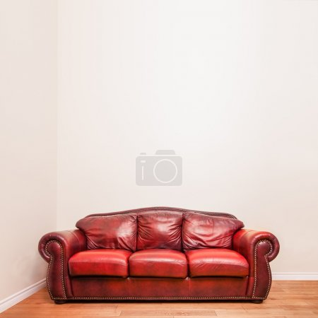 Photo for Luxurious Red Leather Couch in front of a blank wall to ad your text, logo, images, etc. - Royalty Free Image