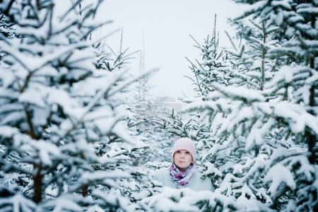 Photo for Lost Woman during a Cold Winter Day in Forest - Royalty Free Image