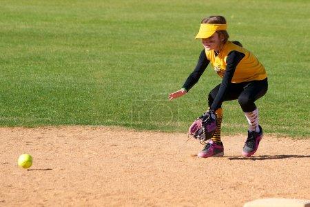 Softball Player Fielding a Ground Ball