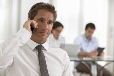 Businessman using a smartphone during a meeting