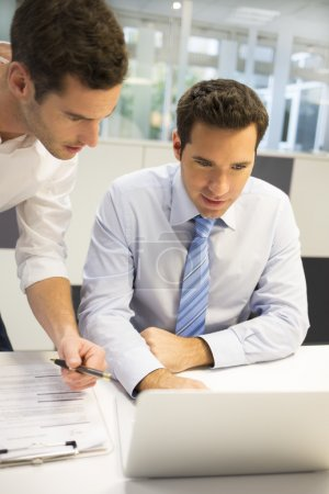 Businessmen working together with laptop
