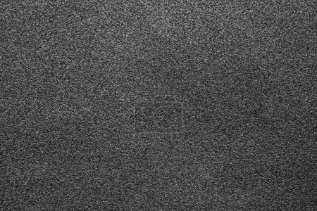 Fine-grained texture of a black abrasive material