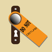 Do not disturb sign hanging on a door knob of a hotel room