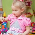 Little girl eating cake on her birthday party...