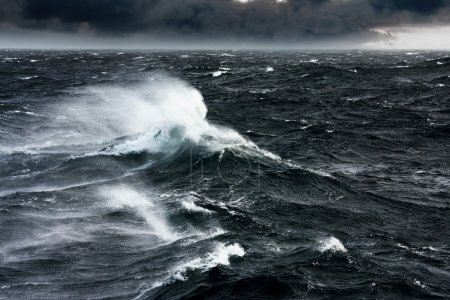 Photo for Waves Breaking and Spraying at High Seas and Strong Winds - Royalty Free Image