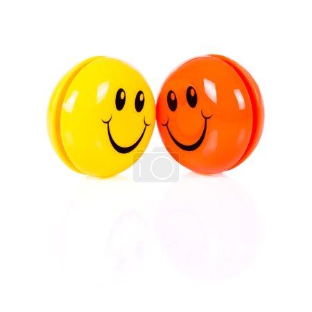 Photo pour Smileys jaunes et oranges isolés sur fond blanc - image libre de droit