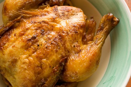 Prepared whole chicken on a plate