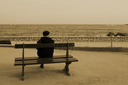 Man on Bench, next to the sea