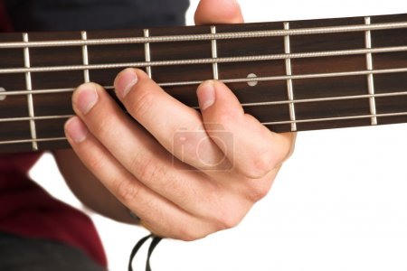 Close-up of person playing guitar.