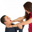 A brunette woman with her eyes closed strangling h...