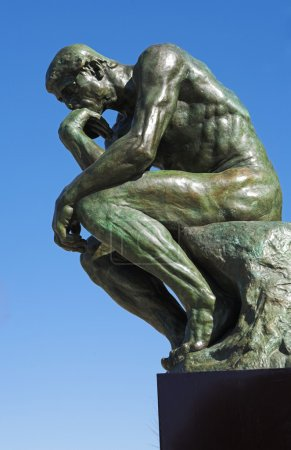 A copy of the famous bronze sculpture of Auguste Rodin The Thinker
