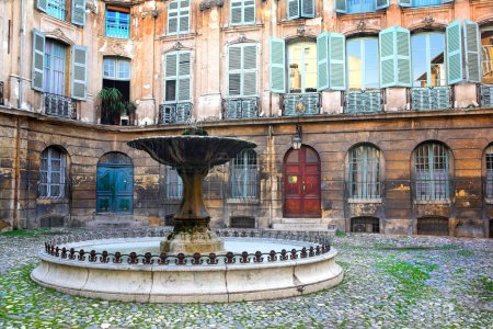 Courtyard with a fountain in Aix-en-Provence, France.