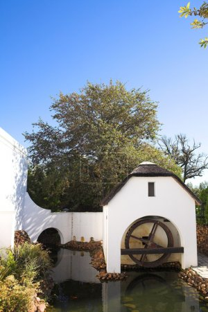 Old watermill next to winery on Plaisir de Merle, South Africa, on a sunny summers day
