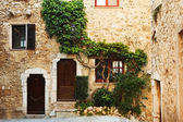 Buildings with windows and doors in the quaint little French hilltop village of Saint-Paul de Vence, Southern France,