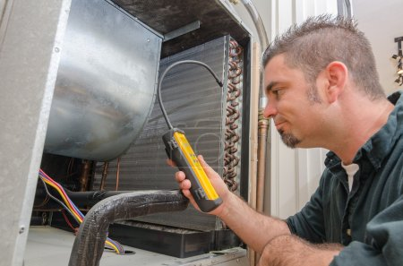 HVAC Technician with Leak Detector