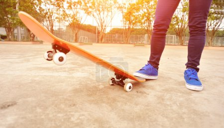 Photo for Leg in sneaker on a skateboard - Royalty Free Image