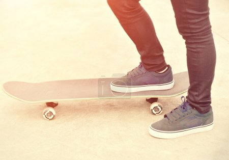 Legs on a skateboard