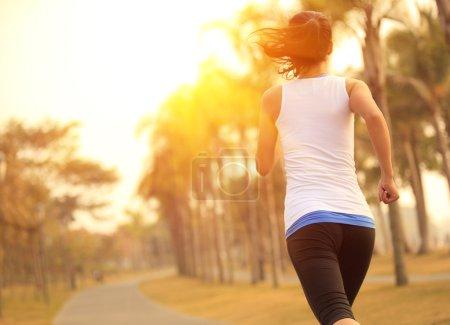 Woman running on wooden trail seaside