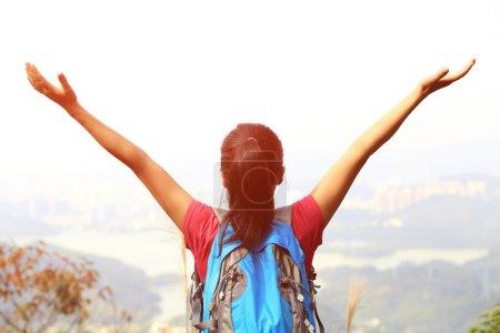 Woman climber on mountain peak