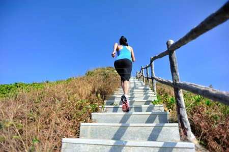 Woman running up on the  stairs