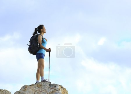 Woman enjoy view at mountain peak