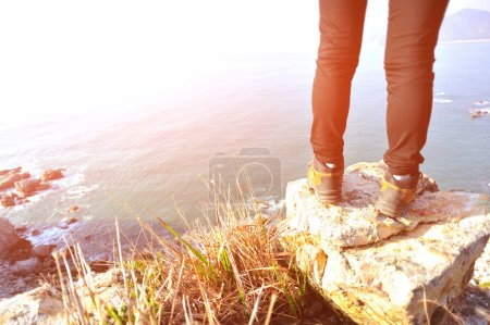 Legs on mountain rock