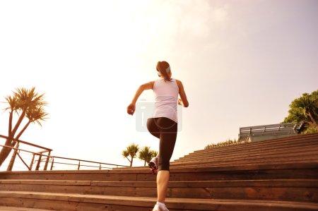 Female runner at sunrise