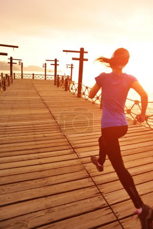Photo for Healthy lifestyle woman running at sunrise - Royalty Free Image
