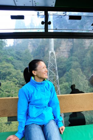 Woman travel in ropeway