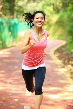 Asian woman jogging at park
