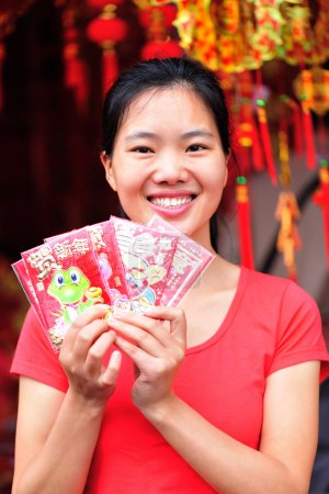 Woman wishing you a happy chinese new year