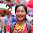 Travel asian woman with a cup of coffee smile at s...