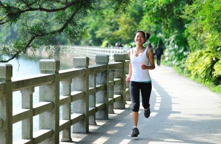 Asian woman jogging at park